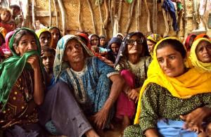 Women watch election results in Pakistan