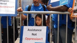 A young girl takes part in a demonstration for refugee rights in Hong Kong