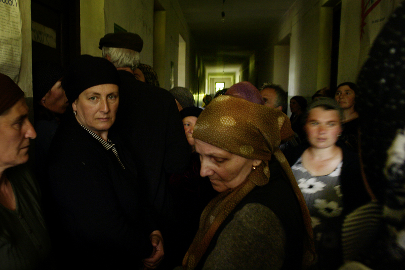 Chechen women refugees wait in a corridor. Credit: Demotix.