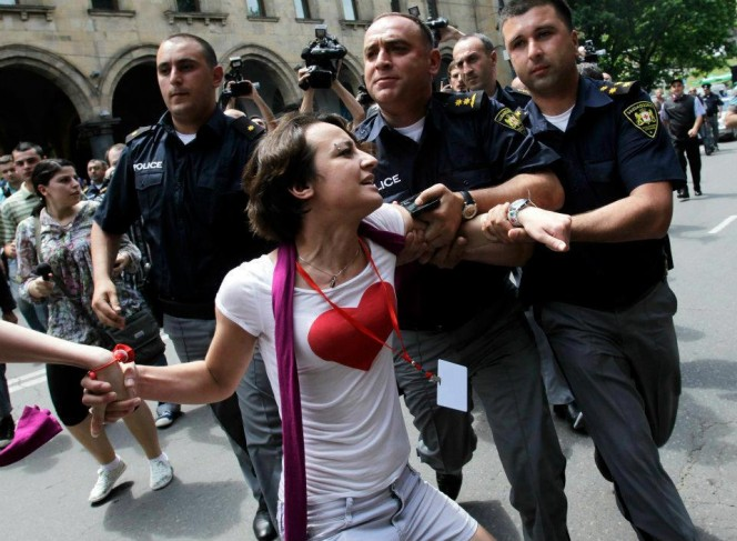 A woman is detained by police at an IDAHO rally in Tbilisi, Georgia on May 17, 2012.