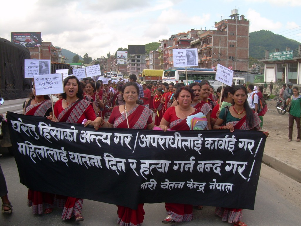 Women participate in a mass demonstration against dowry killings