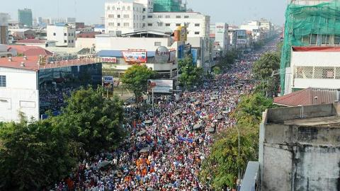 Garment workers march through the streets of Phnom Penh, Cambodia.