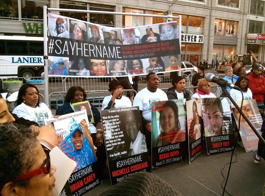 Family members hold up pictures of women of color who have been murdered by police violence during a vigil in New York, May 20, 2015. Photo Credit: Shalini Eddens